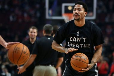 Dec. 6, 2014 - Chicago, IL, USA - Chicago Bulls guard Derrick Rose wears a shirt reading ''I Can't Breath'' while warming up for a game against the Golden State Warriors on Saturday, Dec. 6, 2014 at the United Center in Chicago. (Credit Image: © Chris Sweda/TNS/ZUMA Wire)